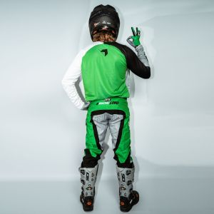 model wearing green born 2 race motorsports kit showing the back view