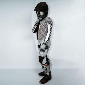 model wearing black scribble motorsports kit showing side view