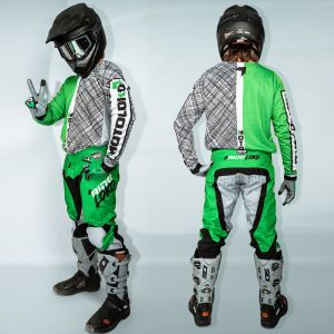 Model wearing green scribble motorsports kit showing back and side view of kit