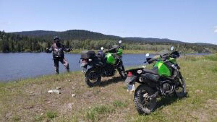 2 Kawasaki KLR 650's next to an Alpine lake near Lillooet Motorcycle tour Pemberton