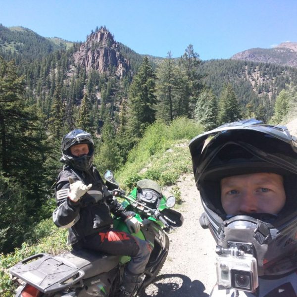 Jody Tracey and Ben Harris, Moto Experience guides having some fun on a dirt road