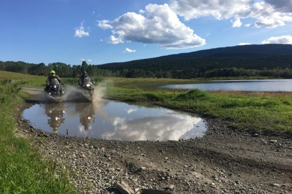 Motorcycle tour on Hat Creek Road near Cache Creek Road