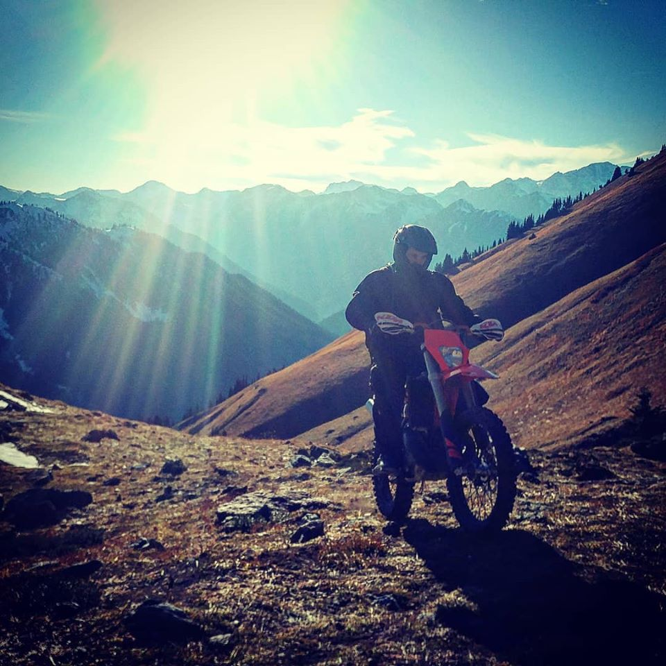 Byrn Hughes ripping his KTM dirt bike up a rock face