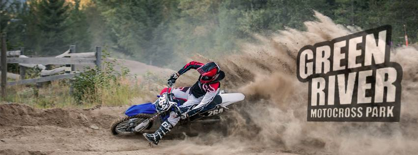 dirt bike spraying dirt in the air with a green river motocross park text overlay