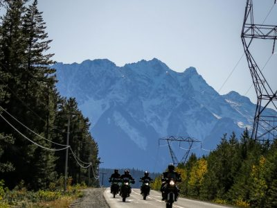 2 motorcycles riding in the Callaghan valley with Blacktusk in the background