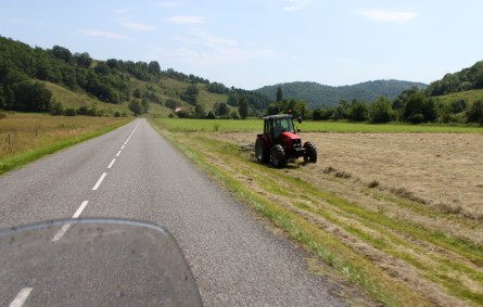 Nothing on the road and a tractor at work in a field creates a wonderful smell of cut grass