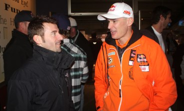 Max Biaggi and Stefan Everts chat at the Supercross