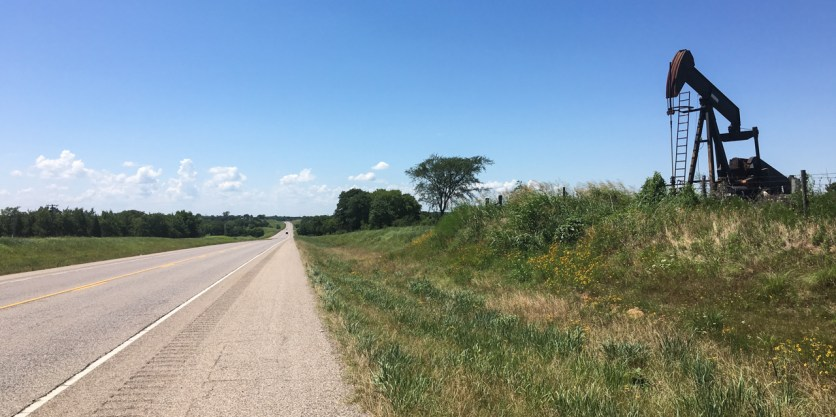 More endless roads in Oklahoma, sided by oil pumps