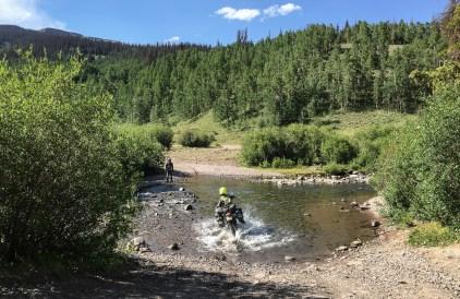 Janine taking a slalom line through the creek