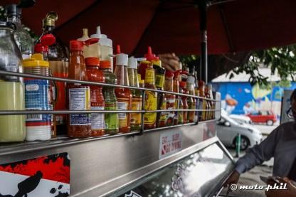 Many bottles of spicy salsas at La Paz Tacos