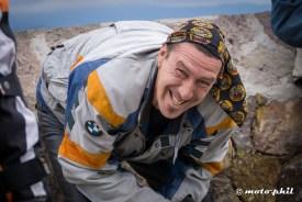 Uli Schäfer with a BMW jacket and bandana smiling big times