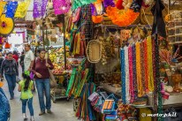 Mexican market with colorful fruits and art