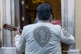 Mariachi with white jacket with nice accents from the back