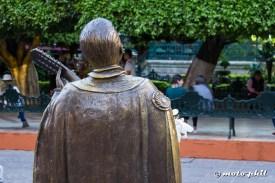 Mariachi Statue from the back at Jardin de la Union in Guanajuato