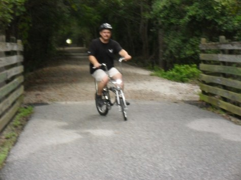 Here we have a large man on a small bicycle! Having loads of fun too.
