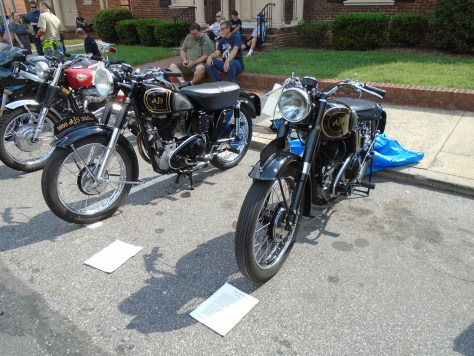 < antique AJS motorcycles>