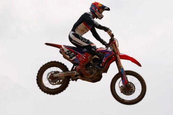 Ken Roczen jumps through the air on his Honda motocross bike in the 2019 Red Bull Redbud National MX race