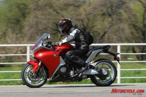 The VFR's bars are slightly higher than the K1300's, but it has a slightly shorter seat-to-peg distance.