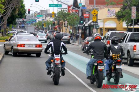 Yep, that's us riding in the bicycle lane. If the cagers get away with it, we almost qualify. Note how low my 6-foot frame (right) looks when cramped on the Native, next to the 5-foot, 8-inch guys on the taller bikes to the left.