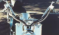 All of the handlebar wires and cables funnel into a scoop atop the headlight cell.