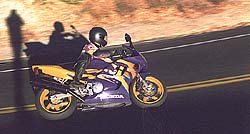 Plush, well-damped suspension and sticky stock tires make Honda's F3 an excellent all-around street bike.