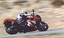 """Shawn Higbee gets down to business on the Kawasaki at Willow Springs: """"To keep up with Graves when he was cruising on the Suzuki,"""" Higbee tells us, """"I had to ride the wheels off the Kawasaki, power-sliding it out of turns."""""""