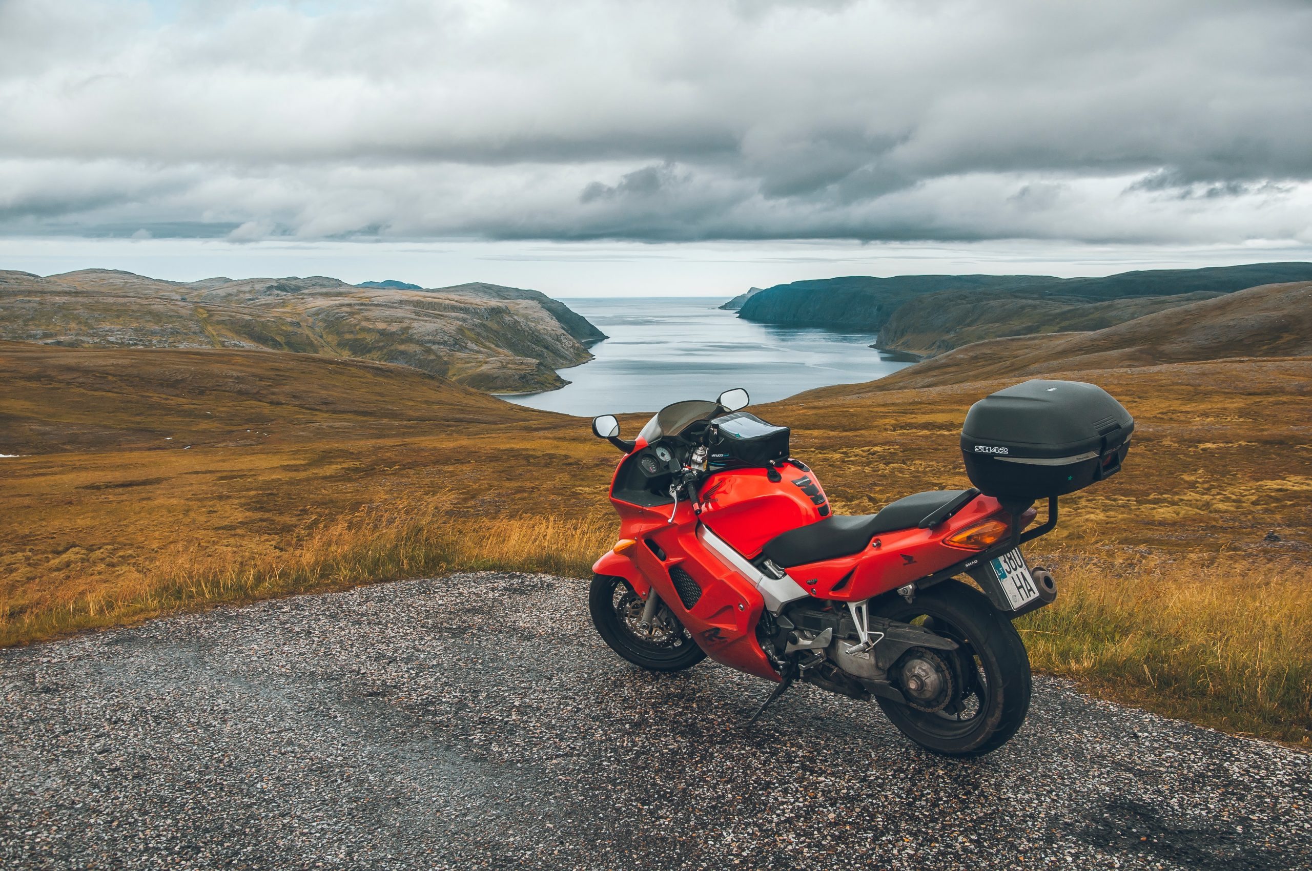 A motorcycle by sea. Reasons not to buy panniers.