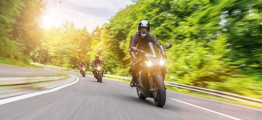 motorcycle on country lane - motorcycle touring for beginners