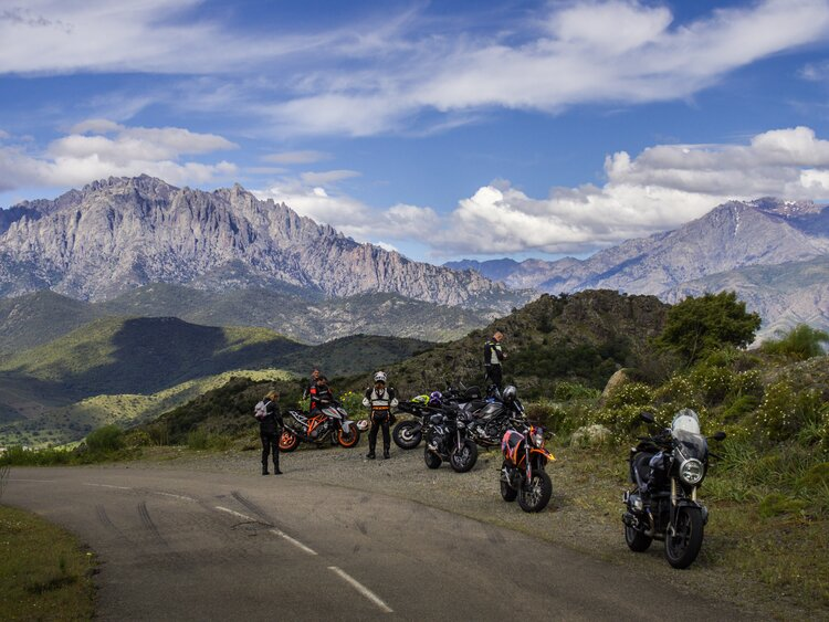 group of motorcyclists in mountains
