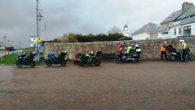 bikers in fishing port - motorcycle touring rain gear