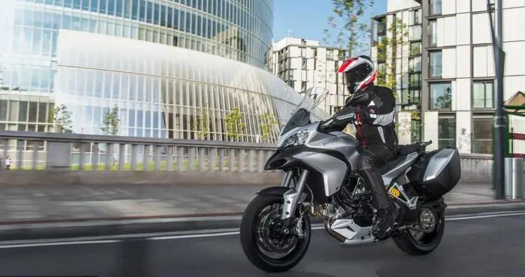 motorcyclist riding silver ducati multistrada
