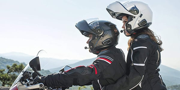 rider and pillion with motorcycle bluetooth headsets