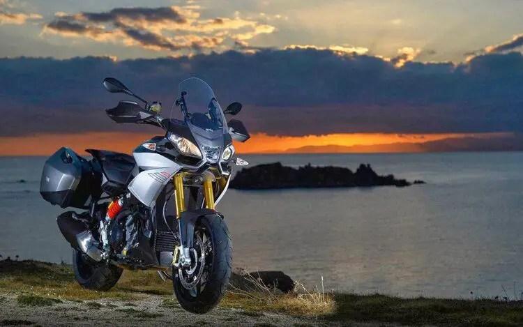 aprillia adventure bike offroad at sunset