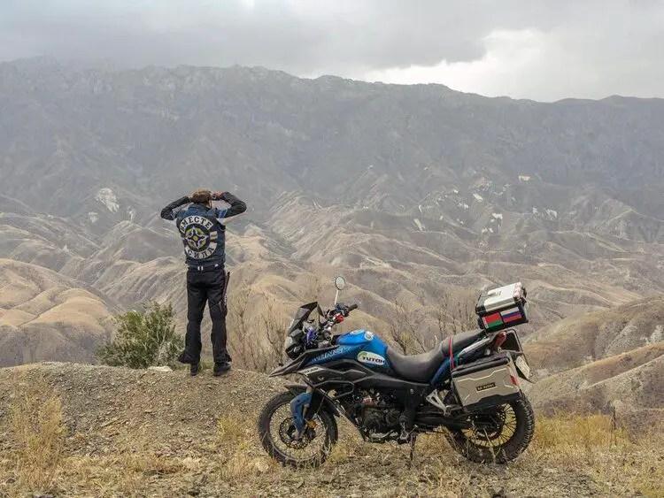 biker offroad on cliff edge