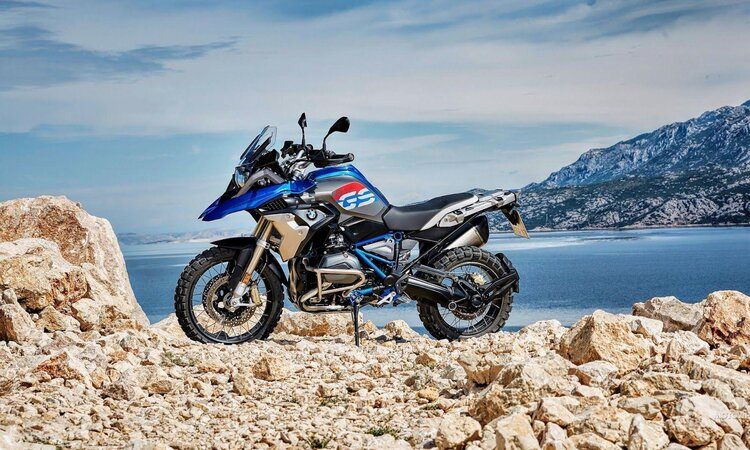 adventure motorcycling on a bmw gs - offroad by lake