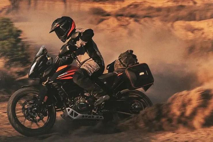 ktm kicking up dust in the desert - adventure motorcycling