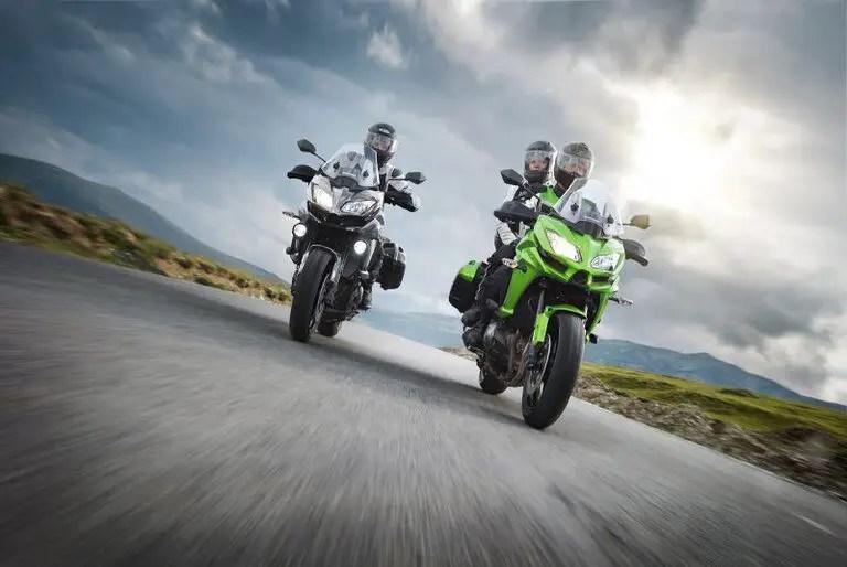 rider and passenger on kawasaki versys