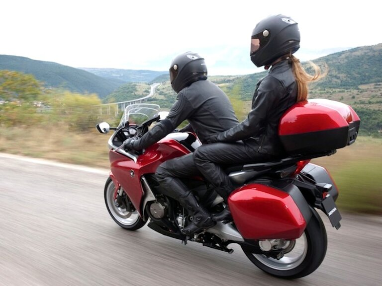 red honda vfr 1200 - touring with a pillion