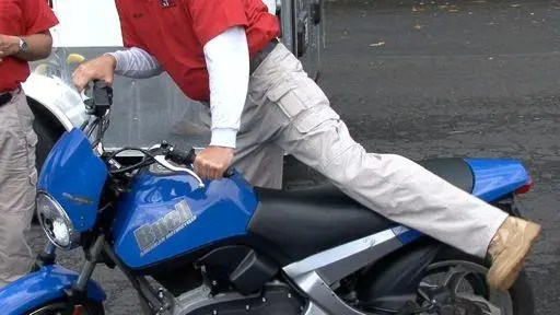 man getting off motorcycle