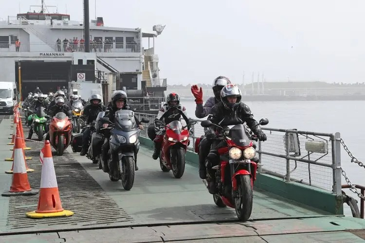 bikers coming off ferry - solo motorcycle touring
