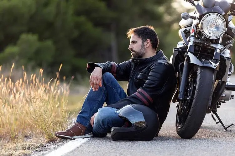 motorcyclist broken down