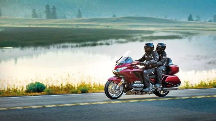 honda goldwing with pillion on road with field and fog - long-distance motorcycling