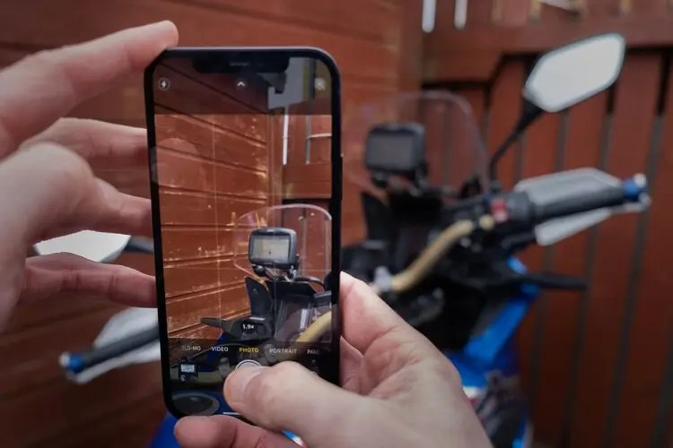 shooting bike with iphone 12 and garmin motorcycle sat-nav