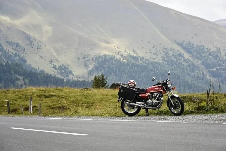 retro honda motorcycle in mountains - motorcycle touring mistakes