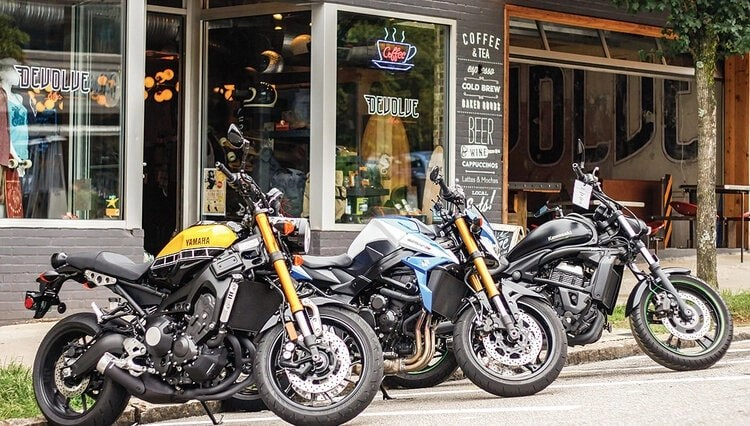 motorcycles outside cafe - motorcycle travel