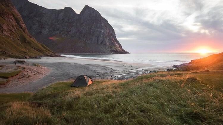 tent on beach at sunrise