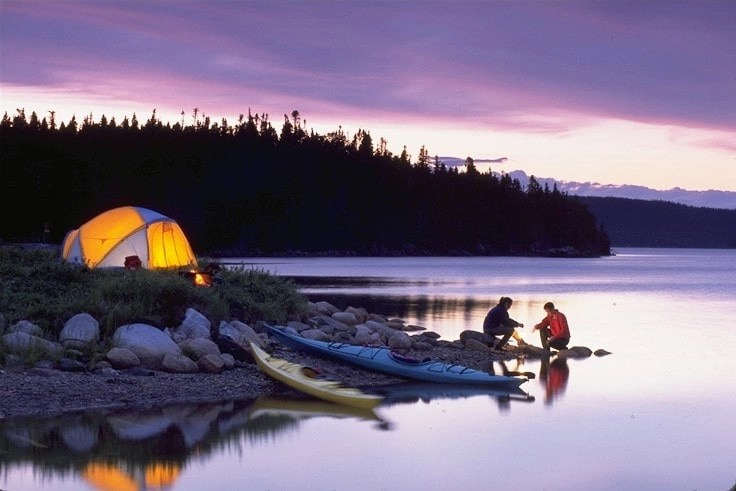 tent by lake at sunset