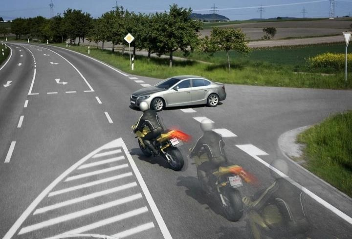 car pulling out on motorcycle