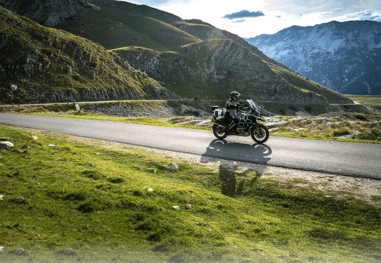 bmw in mountains - motorcycle travel benefits