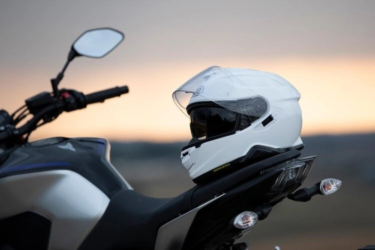 quietest motorcycle helmets - shoei on back of motorcycle